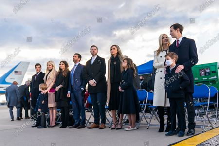 From left, Tiffany Trump and her fiancé Michael Boulos, Donald Trump Jr., and his girlfriend Kimberly Guilfoyle, Eric Trump and his wife Lara Trump and their children and Ivanka Trump and her husband Jared Kushner and their children Theodore, Joseph and Arabella wait for President Donald Trump to arrive at Andrews Air Force Base, Md