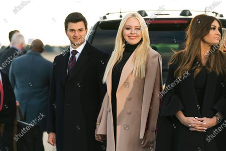 From left, Tiffany Trump, center, and her fiance Michael Boulos, left, and Donald Trump Jr's girlfriend Kimberly Guilfoyle, right, wait for President Donald Trump to arrive at Andrews Air Force Base, Md