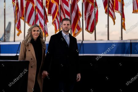 Stock Image of Eric Trump, executive vice president of Trump Organization Inc., right, and his wife Lara Trump, arrive to a farewell ceremony at Joint Base Andrews, Maryland, USA, 20 January 2021. US President Donald J. Trump is not attending the Inaugration ceremony of President-elect Joe Biden. Biden won the 03 November 2020 election to become the 46th President of the United States of America.