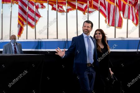 Donald Trump Jr., executive vice president of development and acquisitions for Trump Organization Inc., left, and his partner Kimberly Guilfoyle , arrive to a farewell ceremony at Joint Base Andrews, Maryland, USA, 20 January 2021. US President Donald J. Trump is not attending the Inaugration ceremony of President-elect Joe Biden. Biden won the 03 November 2020 election to become the 46th President of the United States of America.