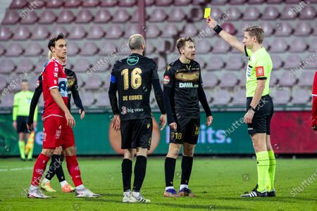 Kortrijk's Trent Sainsbury receives a yellow card from referee Lawrence Visser during a soccer match between KV Kortrijk and Sint-Truidense VV STVV, Wednesday 20 January 2021 in Kortrijk, on day 25 of the 'Jupiler Pro League' first division of the Belgian championship.