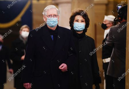 Sen. Mitch McConnell (R-Ky.) and former Secretary of Transportation Elaine Chao arrive in the Crypt of the US Capitol for President-elect Joe Biden's inauguration ceremony on in Washington