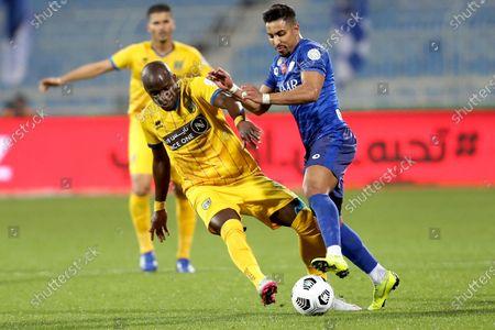 Al-Hilal's player Salem Al-Dawsari (R) in action against Al-Taawoun's Abdoulaye Sane (L) during the Saudi Professional League soccer match between Al-Hilal and Al-Taawoun at Prince Faisal bin Fahd Stadium, Riyadh, Saudi Arabia, 20 January 2021.
