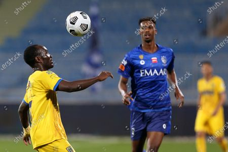 Al-Hilal's player Mohamed Kanno (R) in action against Al-Taawoun's Cedric Amissi (L) during the Saudi Professional League soccer match between Al-Hilal and Al-Taawoun at Prince Faisal bin Fahd Stadium, Riyadh, Saudi Arabia, 20 January 2021.