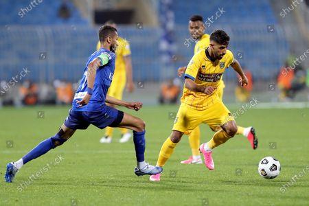 Stock Photo of Al-Hilal's player Salman Al-Faraj (L) in action against Al-Taawoun's Mutair Al Zahrani (R) during the Saudi Professional League soccer match between Al-Hilal and Al-Taawoun at Prince Faisal bin Fahd Stadium, Riyadh, Saudi Arabia, 20 January 2021.