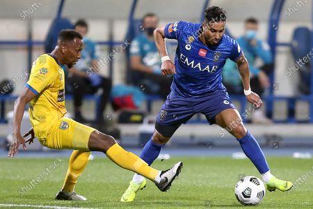 Al-Hilal's player Salem Al-Dawsari (R) in action against Al-Taawoun's Hassan Kadesh (L) during the Saudi Professional League soccer match between Al-Hilal and Al-Taawoun at Prince Faisal bin Fahd Stadium, Riyadh, Saudi Arabia, 20 January 2021.