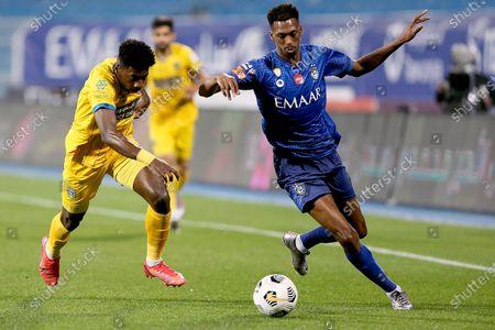 Al-Hilal's player Mohamed Kanno (R) in action against Al-Taawoun's Yaseen Barnawi (L) during the Saudi Professional League soccer match between Al-Hilal and Al-Taawoun at Prince Faisal bin Fahd Stadium, Riyadh, Saudi Arabia, 20 January 2021.