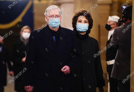 Senate Majority Leader Mitch McConnell and former Secretary of Transportation Elaine Chao (R) arrive in the Crypt of the US Capitol for President-elect Joe Biden's inauguration ceremony to be the 46th President of the United States in Washington, DC, USA, 20.