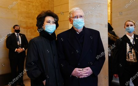 Senate Majority Leader Mitch McConnell (R) and former Secretary of Transportation Elaine Chao (L) before President-elect Joe Biden arrives at the East Front of the US Capitol for his inauguration ceremony to be the 46th President of the United States in Washington, DC, USA, 20.