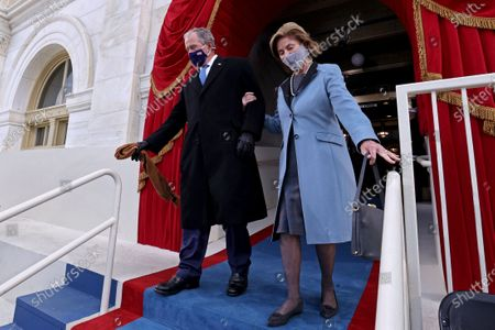 Former U.S President George W. Bush and his wife Laura Bush arrive for the inauguration of Joe Biden as the 46th President of the United States on the West Front of the U.S. Capitol in Washington, U.S.,. REUTERS/Jonathan Ernst/Pool