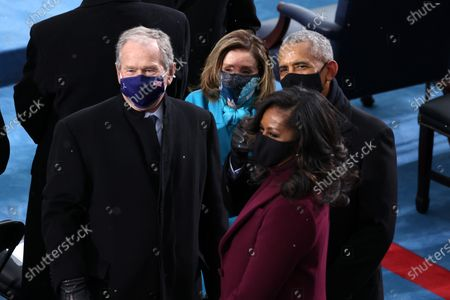 WASHINGTON, DC - JANUARY 20: Former U.S. President George W. Bush, Speaker of the House Nancy Pelosi (D-CA), former U.S. President Barack Obama and Michelle Obama arrive at the inauguration of U.S. President-elect Joe Biden on the West Front of the U.S. Capitol in Washington, DC. During today's inauguration ceremony Joe Biden becomes the 46th president of the United States. (Photo by Tasos Katopodis/Getty Images)