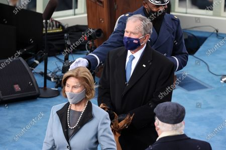 WASHINGTON, DC - JANUARY 20: Former U.S. President George W. Bush and Laura Bush arrive to the inauguration of U.S. President-elect Joe Biden on the West Front of the U.S. Capitol in Washington, DC. During today's inauguration ceremony Joe Biden becomes the 46th president of the United States. (Photo by Tasos Katopodis/Getty Images)