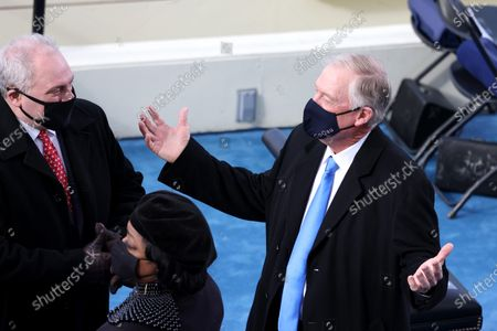WASHINGTON, DC - JANUARY 20: U.S. House Minority Whip Steve Scalise (R-LA) (L) speaks to former U.S. Vice President Dan Quayle as they arrive at the inauguration of U.S. President-elect Joe Biden on the West Front of the U.S. Capitol in Washington, DC. During today's inauguration ceremony Joe Biden becomes the 46th president of the United States. (Photo by Tasos Katopodis/Getty Images)