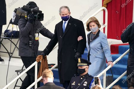 NYTINAUG - Former President George W. Bush and Laura Bush arrived. The inauguration ceremony for President Joe Biden and Vice President Kamala Harris on the west front of the U.S. Capitol in Washington. NYTCREDIT: Erin Schaff/The New York Times