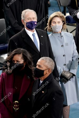 Former president George W. Bush and Laura Bush are seen prior to the 59th Presidential Inauguration at the U.S. Capitol in Washington, D.C.