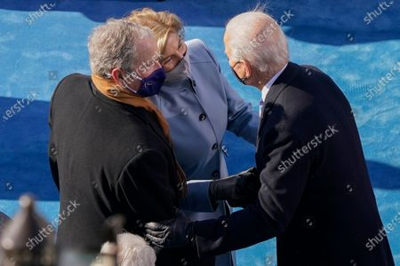 President Joe Biden greeting former President George Bush and his wife Laura Bush, during the 59th Presidential Inauguration at the U.S. Capitol in Washington,. (AP Photo/Susan Walsh, Pool)