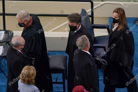 From l-r., House Minority Whip Steve Scalise, R-La., U.S. Supreme Court Associate Justice Neil M. Gorsuch, Supreme Court Justice Brett Kavanaugh, former President George W. Bush, and Supreme Court Justice Amy Coney Barrett, at the 59th Presidential Inauguration at the U.S. Capitol in Washington,. (AP Photo/Susan Walsh, Pool)
