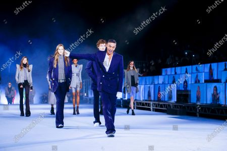Olivier Rousteing on the catwalk at the Balmain Fashion show in Paris, Spring Summer 2021, Ready to Wear Fashion Week