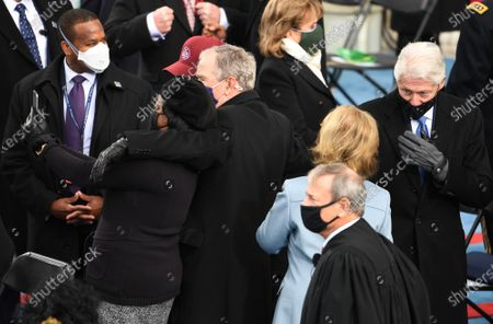 Former President George W. Bush (C) takes a selfie with a guest as he arrives to witness President Joseph Robinette Biden Jr. take the oath of office as the 46th President of the United States in Washington, DC on Wednesday, January 20, 2021.