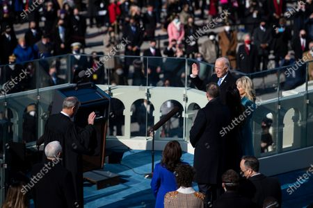 UNITED STATES - January 20: President Joe Biden is sworn in as the 46th President of the United States by Supreme Court Chief Justice John Roberts on the West Front of the Capitol. (Photo by Caroline Brehman/CQ Roll Call)