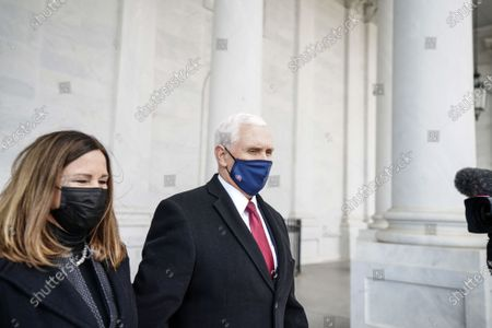 WASHINGTON, DC - JANUARY 20, 2021: Former Vice President Mike Pence and his wife, Karen Pence, after the inauguration of President Joe Biden in Washington, DC. (Photo by Melina Mara/The Washington Post/POOL)