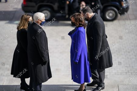 WASHINGTON, DC - JANUARY 20, 2021: Former Vice President Mike Pence and his wife, Karen Pence speak with Vice President Kamala D. Harris and Doug Emhoff, after the inauguration of President Joe Biden in Washington, DC. (Photo by Melina Mara/The Washington Post/POOL)