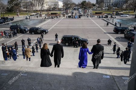WASHINGTON, DC - JANUARY 20, 2021: Former Vice President Mike Pence and his wife, Karen Pence walk down the steps of the U.S. Capitol with Vice President Kamala D. Harris and Doug Emhoff, after the inauguration of President Joe Biden in Washington, DC. (Photo by Melina Mara/The Washington Post/POOL)