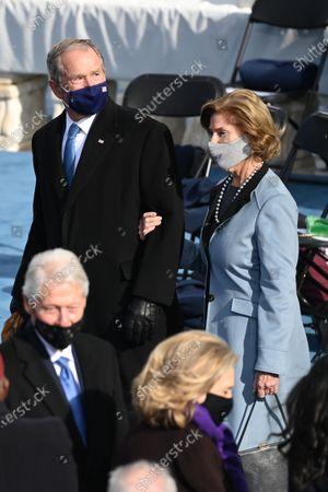 Former US President George W Bush (Top, L), Laura Bush (Top,R) and Former US Presiednt Bill Clinton (Low, L) with Secretary of State Hillary Clinton (Low, R) are seen before US president-elect Joe Biden is sworn in as the 46th US President, at the US Capitol in Washington, DC. - Biden, a 78-year-old former vice president and longtime senator, takes the oath of office at noon (1700 GMT) on the US Capitol's western front, the very spot where pro-Trump rioters clashed with police two weeks ago before storming Congress in a deadly insurrection.