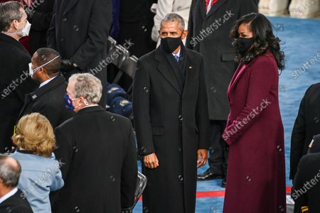 Former US President Barrack Obama (C) and Michelle Obama look on as former US President George W Bush (2ndL) wait before US president-elect Joe Biden is sworn in as the 46th US President, at the US Capitol in Washington, DC. - Biden, a 78-year-old former vice president and longtime senator, takes the oath of office at noon (1700 GMT) on the US Capitol's western front, the very spot where pro-Trump rioters clashed with police two weeks ago before storming Congress in a deadly insurrection.