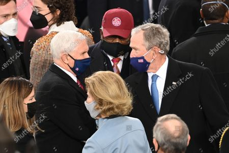 Stock Photo of Outgoing US Vice President Mike Pence (L)talks with Former US President George W. Bush before US President-elect Joe Biden is sworn in as the 46th US President, at the US Capitol in Washington, DC. - Biden, a 78-year-old former vice president and longtime senator, takes the oath of office at noon (1700 GMT) on the US Capitol's western front, the very spot where pro-Trump rioters clashed with police two weeks ago before storming Congress in a deadly insurrection.