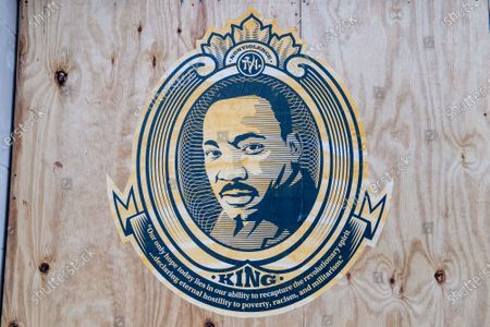 An emblem of Dr. Martin Luther King is seen on a boarded building as preparations are made to enhance security before the presidential inauguration on January 19, 2021 in Washington DC. Over 20,000 National Guard troops are expected to assemble following the riots at the U.S Capitol building.