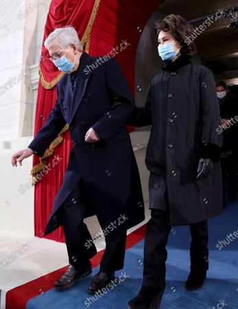 Sen. Mitch McConnell (R-Ky.) and his wife, former Secretary of Transportation Elaine Chao, arrive for the 59th Presidential Inauguration at the U.S. Capitol in Washington, . Joe Biden became the 46th president of the United States on Wednesday