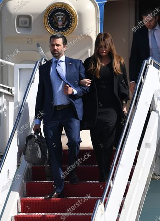 Donald Trump Jr and Kimberly Guilfoyle arrive on Air Force One at Palm Beach International Airport