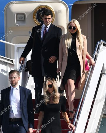 Tiffany Trump, Michael Boulos, Eric Trump Jr and Lara Trump arrive on Air Force One at Palm Beach International Airport