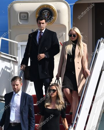 Stock Photo of Tiffany Trump, Michael Boulos, Eric Trump Jr and Lara Trump arrive on Air Force One at Palm Beach International Airport