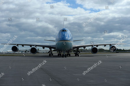 Air Force One is seen as US President Donald Trump and First Melania Trump arrive at Palm Beach International Airport