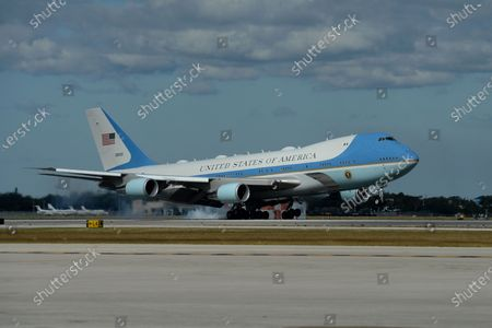 Air Force One is seen as US President Donald Trump and First Melania Trump arrive at Palm Beach International Airport in West Palm Beach
