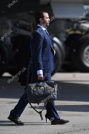 Stock Photo of Donald Trump Jnr and Kimberly Guilfoyle arrive on Air Force One at Palm Beach International Airport