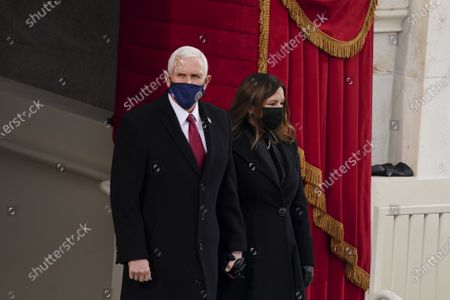 U.S. Vice President Mike Pence and Second Lady Karen Pence arrive to the 59th presidential inauguration in Washington, D.C., U.S., on Wednesday, Jan. 20, 2021. Biden will propose a broad immigration overhaul on his first day as president, including a shortened pathway to U.S. citizenship for undocumented migrants - a complete reversal from Donald Trump's immigration restrictions and crackdowns, but one that faces major roadblocks in Congress.
