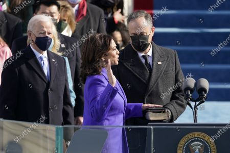 Stock Image of Kamala Harris is sworn in as vice president by Supreme Court Justice Judge Sonia Sotomayor as her husband Doug Emhoff holds the Bible during the 59th Presidential Inauguration at the U.S. Capitol in Washington, Wednesday, Jan. 20, 2021.