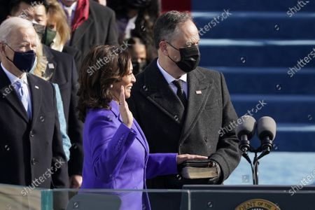 Stock Photo of Kamala Harris is sworn in as vice president by Supreme Court Justice Judge Sonia Sotomayor as her husband Doug Emhoff holds the Bibleat the U.S. Capitol for the inauguration of President Joe Biden at the 59th Presidential Inauguration on Wednesday, January 20, 2021 in Washington DC. Pool Photo by Patrick Semansky/UPI