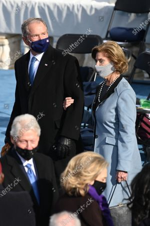 Former US President George W Bush (Top, L), Laura Bush (Top,R) and Former US Presiednt Bill Clinton (Low, L) with Secretary of State Hillary Clinton (Low, R) are seen before US president-elect Joe Biden is sworn in as the 46th US President on January 20, 2021, at the US Capitol in Washington, DC. Biden, a 78-year-old former vice president and longtime senator, takes the oath of office on the US Capitol's western front, the very spot where pro-Trump rioters clashed with police two weeks ago before storming Congress in a deadly insurrection.