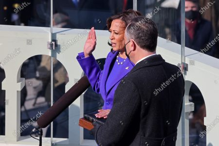 Kamala Harris is sworn in as vice president by Supreme Court Justice Judge Sonia Sotomayor as her husband Doug Emhoff holds the Bibleat the U.S. Capitol for the inauguration of President Joe Biden at the 59th Presidential Inauguration on Wednesday, January 20, 2021 in Washington DC.
