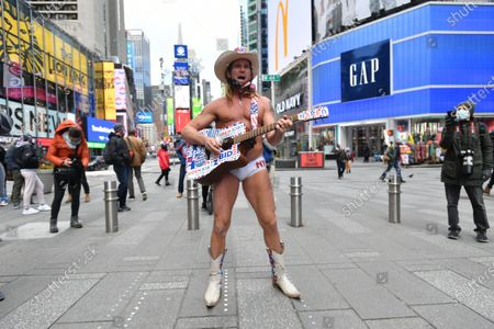 The Naked Cowboy gathes to celebrate the inauguration of Joe Biden as the 46th President of the United States while in Times Square on January 20, 2021 in New York.
