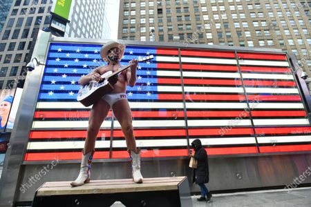 Robert Burck, aka The Naked Cowboy, gathers to celebrate the inauguration of Joe Biden as the 46th President of the United States while in Times Square on January 20, 2021 in New York.