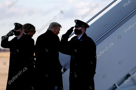 U.S. President Donald Trump, second right, and U.S. First Lady Melania Trump, second left, board Air Force One during a farewell ceremony at Joint Base Andrews, Maryland, U.S.,. Trump departs Washington with Americans more politically divided and more likely to be out of work than when he arrived, while awaiting trial for his second impeachment - an ignominious end to one of the most turbulent presidencies in American history. Photographer: Stefani Reynolds/Bloomberg
