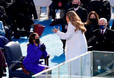 Vice President Kamala Harris reacts after singer Jennifer Lopez performed during the 59th Presidential Inauguration at the U.S. Capitol in Washington, . Former Vice President Mike Pence and wife Karen Pence are on the right