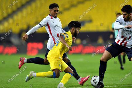 Al-Nassr's player Khalid Al-Ghannam (front) in action against Al-Wehda's Hamad Al Jayzani (back) and Abdullah Al Hafith (R) during the Saudi Professional League soccer match between Al-Nassr and Al-Wehda at King Saud University Stadium, Riyadh, Saudi Arabia, 20 January 2021.