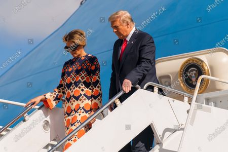Former President Donald Trump and Melania Trump disembark from their final flight on Air Force One at Palm Beach International Airport in West Palm Beach, Fla