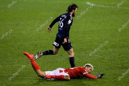 Stock Photo of Lyle Taylor of Nottingham Forest is fouled by Jonathan Howson of Middlesbrough
